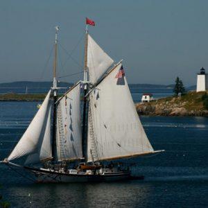Schooner leaving harbor <i>Photo credit: Ann Marie Maguire</i>